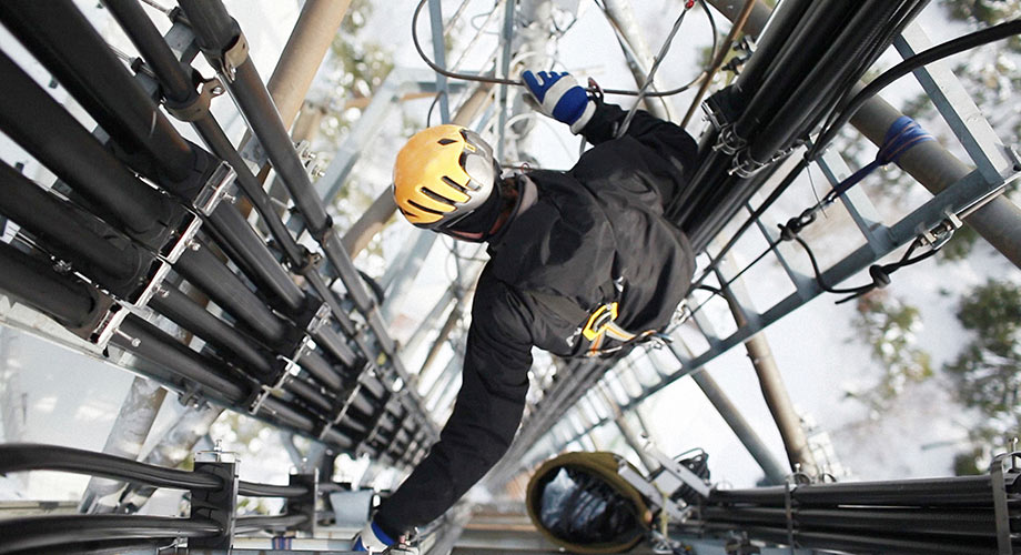 Worker on telecommunication tower